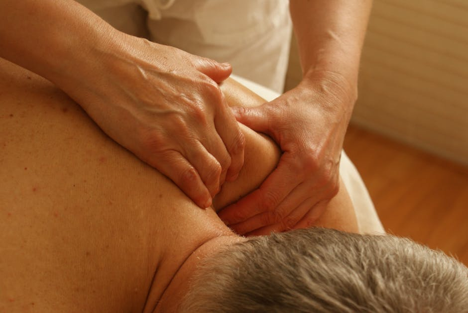 physiotherapist massaging the patient